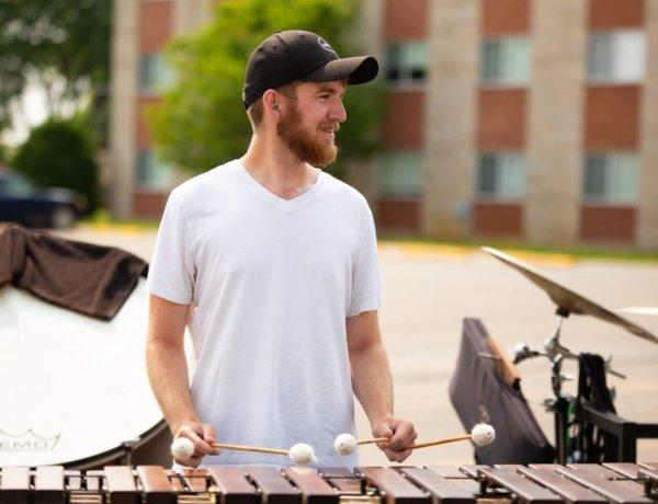Steven Simmermon wearing white tshirt behind a marimba