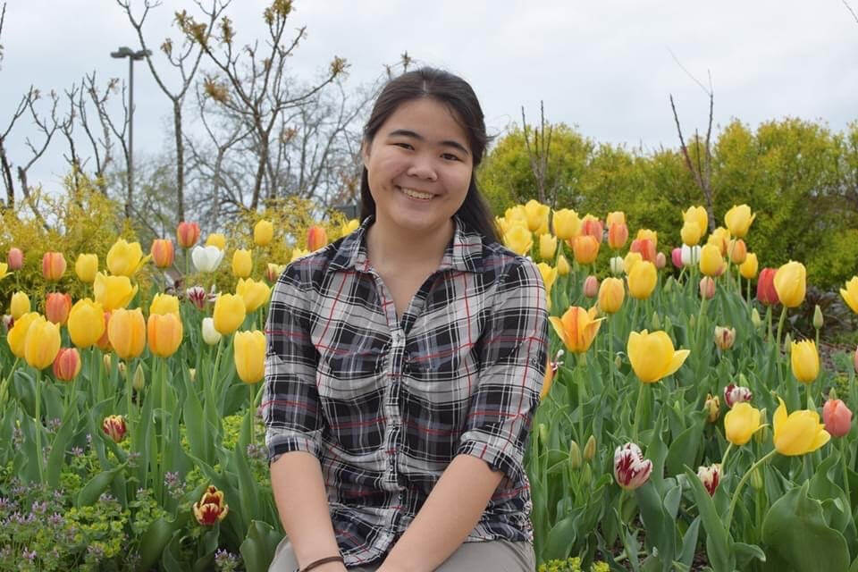 Sophia Puang in a tulip field